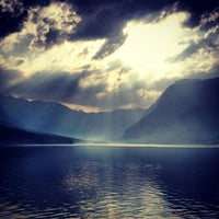 Photo taken at Bohinjsko jezero (Bohinj Lake) by Andraz S. on 7/2/2012
