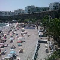 Photo taken at El Salón Beach by Lokynea M. on 8/23/2012