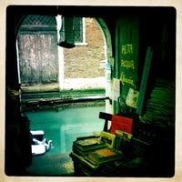 Photo taken at Libreria Acqua Alta by Monica C. on 1/4/2012