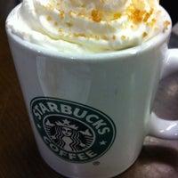 Photo taken at Starbucks by Jacek S. on 12/1/2011