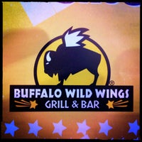 Photo taken at Buffalo Wild Wings Grill & Bar by Eric K. on 4/13/2012