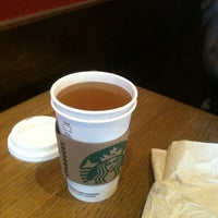 Photo taken at Starbucks by Sam H. on 3/12/2012