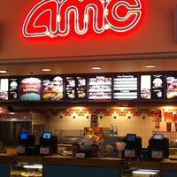 Photo taken at AMC Dine-in Theatres Coral Ridge 10 by Ruben G. on 8/22/2011