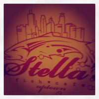 Photo taken at Stella's Fish Cafe & Prestige Oyster Bar by Ashley B. on 7/21/2012
