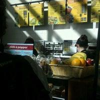 Photo taken at Einstein Bros Bagels by Carion M. on 11/10/2011