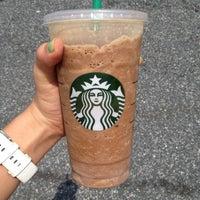 Photo taken at Starbucks by Katie B. on 5/27/2012
