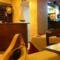 Photo taken at La Taverna by Stefyna B. on 8/4/2012
