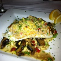 Photo taken at Rapscallion Seafood House and Bar by Cathy V. on 8/4/2012