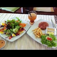Photo taken at Doi Chang Coffee by Alongkorn R. on 9/1/2012