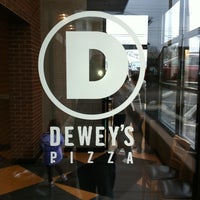 Photo taken at Dewey's Pizza by Justin R. on 2/26/2011