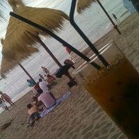 Photo taken at Tuto Beach by Carolina Andrea A. on 1/4/2012