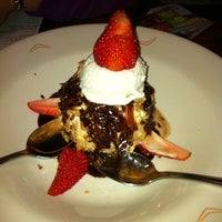 Photo taken at Outback Steakhouse by Krissy S. on 12/21/2010
