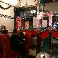 Photo taken at Eddie Rocket's by Jules B. on 12/23/2011
