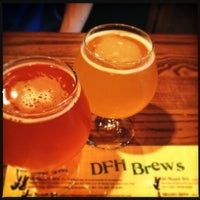 Photo taken at Dogfish Head Alehouse by Jen K. on 3/23/2012