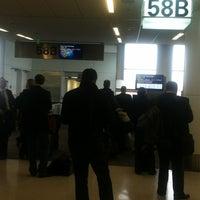 Photo taken at Gate 58B by John P. on 3/14/2012