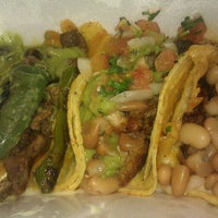 Photo taken at Iguanas Ranas Tacos and Beers by lena l. on 10/21/2011