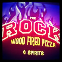 Photo taken at The Rock Wood Fired Kitchen by Katie B. on 12/27/2011