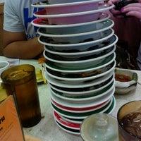 Photo taken at Genki Sushi by Artem R. on 10/30/2011
