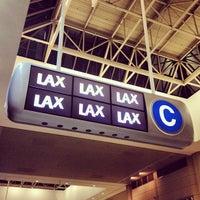 Photo taken at Tom Bradley International Terminal (TBIT) by Mikhail S. on 8/24/2012