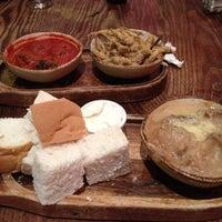 Photo taken at Lui's Wine Bar & Bistro by Phillip J. on 7/8/2012