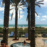 Photo taken at Poolside@ Miami Mariott by Brittany A. on 3/17/2012
