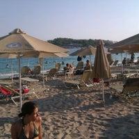 Photo taken at Vouliagmeni Beach by Ilia on 7/26/2012