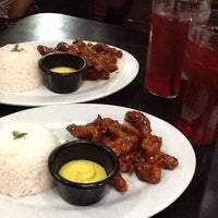 Photo taken at Flaming Wings by Kem M. on 9/6/2012