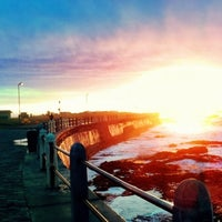 Photo taken at Sea Point Beach Promenade by Warren G. on 5/3/2012