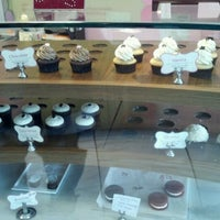 Photo taken at Esther's Cupcakes by Brian S. on 3/24/2012