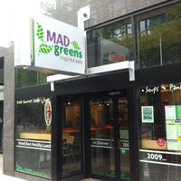 Photo taken at MAD Greens by Nick G. on 5/1/2012