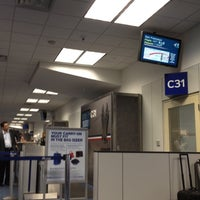Photo taken at Gate C31 by Shaun H. on 6/4/2012