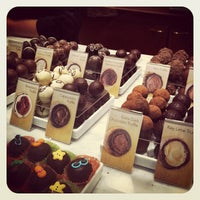 Photo taken at Godiva Chocolatier by Nino P. on 6/18/2012