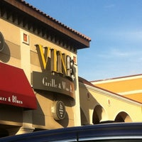 Photo taken at Vines Grille & Wine Bar by André M. on 2/23/2012