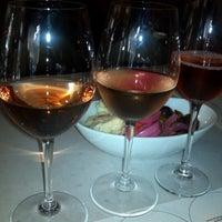 Photo taken at Row 14 Bistro & Wine Bar by Sarah G. on 8/7/2012
