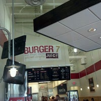 Photo taken at Burger 7 by Carrie C. on 5/19/2012
