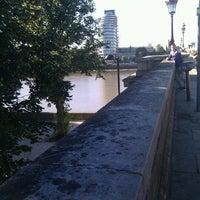 Photo taken at Putney Bridge by Laura K. on 9/13/2012