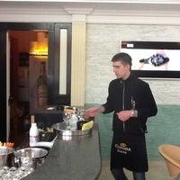 Photo taken at Caffe Bar Atelier Versace by Sinisa J. on 4/14/2012