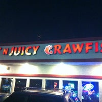 Photo taken at Hot N Juicy Crawfish by Andrew M. on 3/23/2012