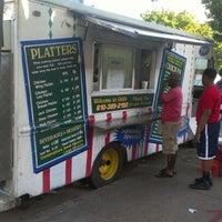 Photo taken at Gigi & Big R Caribbean Soul Food Cart by ZDK T. on 6/16/2012