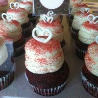 Photo taken at Gigi's Cupcakes by Rebecca G. on 4/21/2012