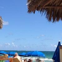 Photo taken at Bamboo Beach Tiki Bar & Cafe by Vero Gili S. on 3/18/2012
