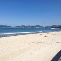 Photo taken at Praia de Samil by Marcos R. on 5/29/2012