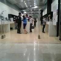 Photo taken at iShop by Jaime Z. on 3/31/2012
