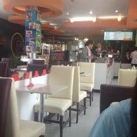 Photo taken at Library Café by D E V I L U C H I F. on 7/27/2012