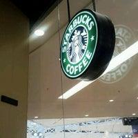 Photo taken at Starbucks by Helbert M. on 3/12/2012