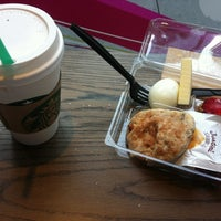 Photo taken at Starbucks by Шикарёва С. on 8/25/2012