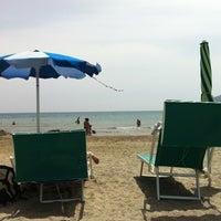 Photo taken at Bassamarea Beach & Sail by Matteo D. on 7/2/2012