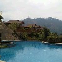 Photo taken at Jambuluwuk Batu Resort by Yenli Z. on 8/21/2012