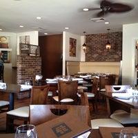 Photo taken at Mezon Tapas Bar & Restaurant by Juan P. on 7/8/2012
