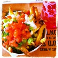 Photo taken at New York Fries by KittyGinaMeow S. on 6/7/2012
